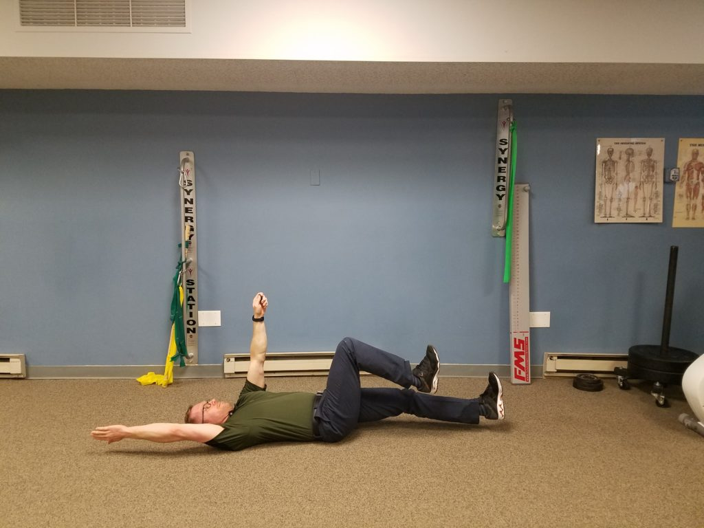 """Dead-Bug: Lie on your back with arms and feet in an """"all fours"""" position. Lower the opposite arm and leg, not allowing your low back to ache. Perform 2 sets, 10 reps, 3 sec hold."""